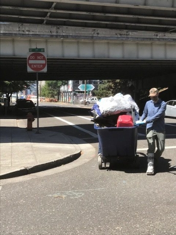 LLoyd EcoDistrict's Joshua Baker taking one large big on garbage to the convention center for disposal.
